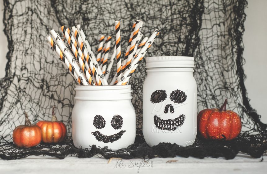 Ghost and skull painted mason jars for Halloween.